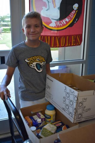 Impact member collects food at the Welcome Back Dance, August 17, 2018.