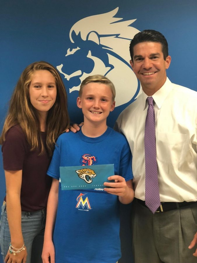 Student council member Ava Poole, Principal Player, and Jag's Tickets Winner, Nate Wicker.