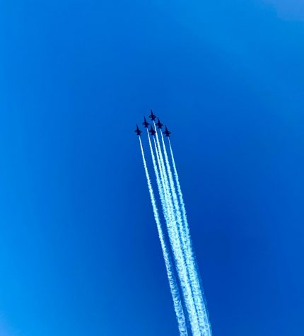 High over PV Beach, the Blue Angles salute medical workers and first responders.