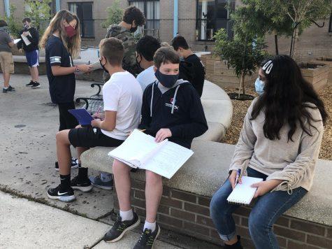 Jennifer Saffarian and Noah Mikle social distance during class.